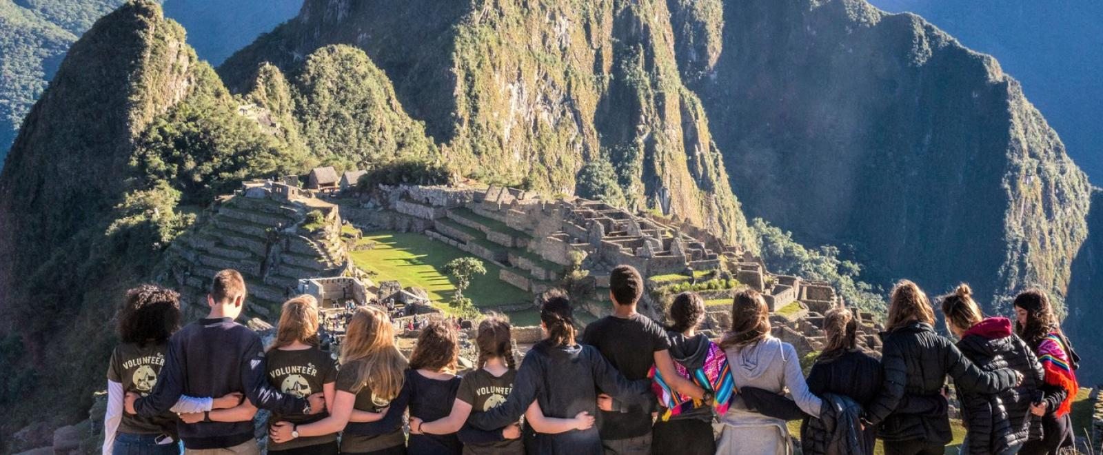A group on a volunteer trip with Projects Abroad visits Machu Picchu over a weekend.